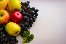 Fall Fruits Still Life. Grapes And Apples On A Light Background With Room For Copying