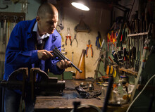Gunsmith Disassembles And Repairs Pistol In A Weapons Workshop