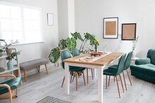 Interior Of Modern Stylish Dining Room With Floral Decor