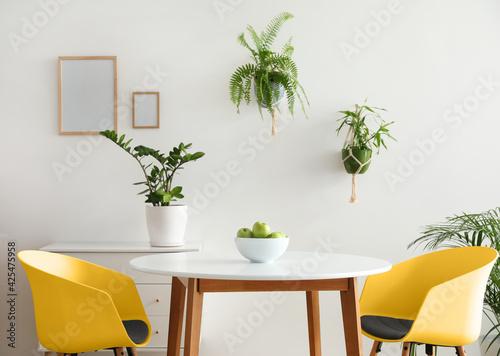 Obraz Interior of modern stylish dining room with houseplants - fototapety do salonu