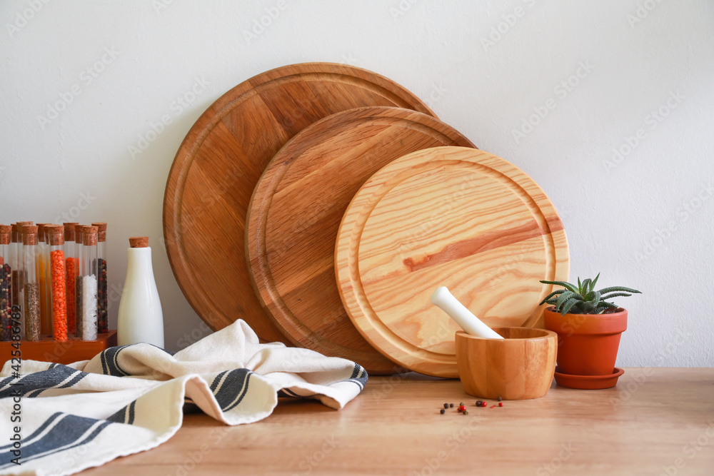 Fototapeta Cutting boards and products on kitchen counter