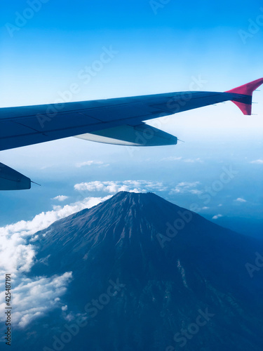 View through a passenger airplane window on a beautiful landscape.