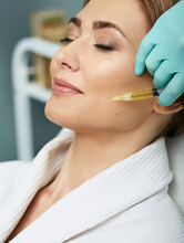 Adult Woman While Face Plasmolifting At A Beauty Clinic. Cosmetology Procedure For Anti-aging Effect On Face Skin
