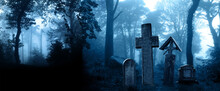 Halloween Scene With Medieval Stone Crosses And  Tombstones In A Cemetery