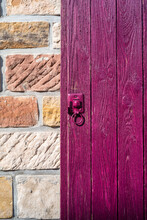 Purple Window Shutter On Vintage Brick Wall