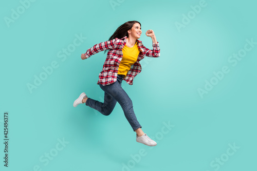 Full length body size view of attractive focused active cheerful girl jumping ru Wallpaper Mural
