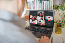 Virtual Graduation And Convocation Ceremony. Laptop Screen With Happy Students Wearing Graduation Gown And Cap Receiving Congratulation During Online Video Call, Distant Education