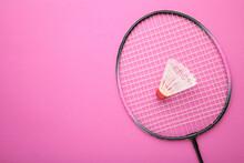 Shuttlecock And Badminton Racket On Pink Background. Badminton Equipment.