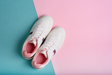 Blue Sport Sneakers Shoes On The Blue And Pink Background.
