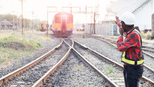 African Engineer   Raised A Hand To Control A The Train On Railway With Talking By Radio Communication Or Walkie Talkie