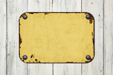 Vintage Yellow Tin Sign On A Wooden Background