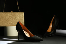 Pair Of Elegant High Heel Shoes And Clutch On Black Background