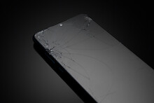 Broken Screen Glass Of Mobile Smartphone On Black Background.