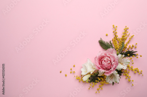 Obraz Beautiful floral composition with mimosa flowers on pink background, flat lay. Space for text - fototapety do salonu