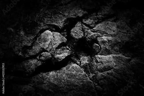 Obraz na plátne Close-up black worn textured stone surface background