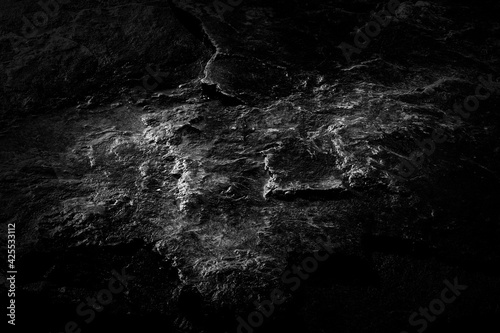 Close-up black worn textured stone surface background Fototapeta