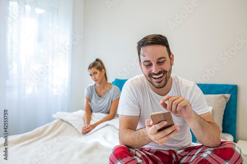 Tela Young attractive couple in relationship problem with internet mobile phone gambl