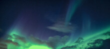 Aurora Borealis Or Northern Lights With Starry Glowing In The Night Sky