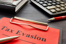 Tax Evasion Result Of Audit With Clipboard.