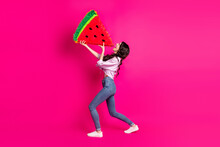 Full Size Profile Side Photo Of Young Happy Cheerful Excited Girl Eating Huge Watermelon Slice Isolated On Pink Color Background