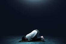 Asian Muslim Man In Praying Position (salat) On Prayer Rug