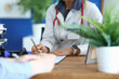 canvas print picture - Doctor makes notes on medical records closeup