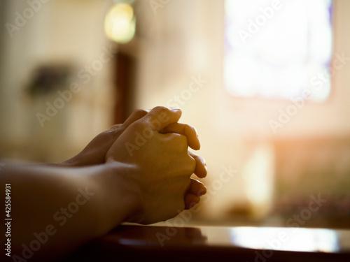 Fototapeta Christian women pray for blessings with faith on a black background