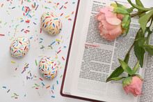 Sprinkle Easter Eggs And Peony Over The Open  Bible
