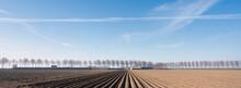 Freshly Plowed Field Early Spring In The Netherlands On The Island Of Goeree En Overflakkee