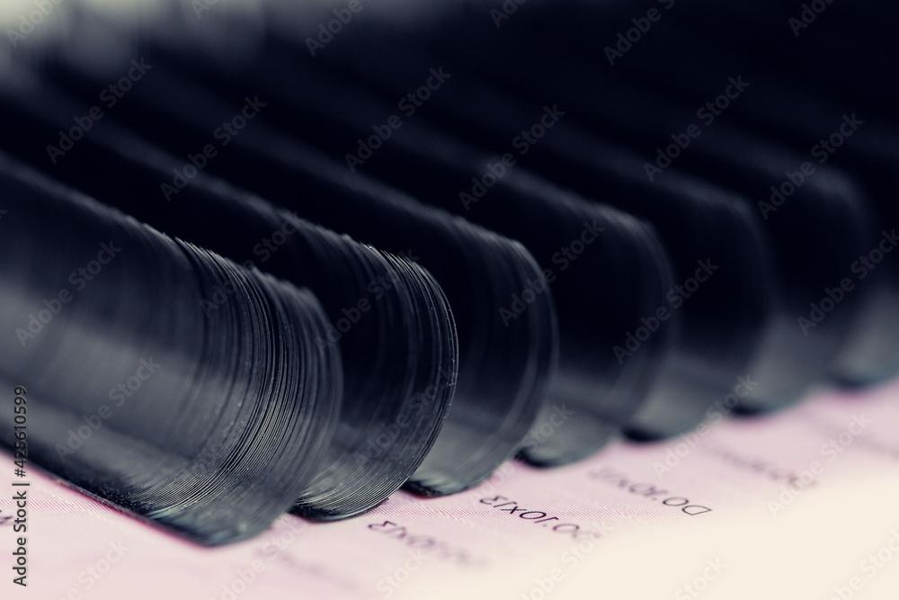 Fototapeta Set artificial black lashes pink isolated background, eyelash extension