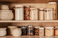 Organizing Zero Waste Storage In The Kitchen. Pasta And Cereals In Reusable Glass Containers In Kitchen Shelf. Sustainable Lifestyle Idea