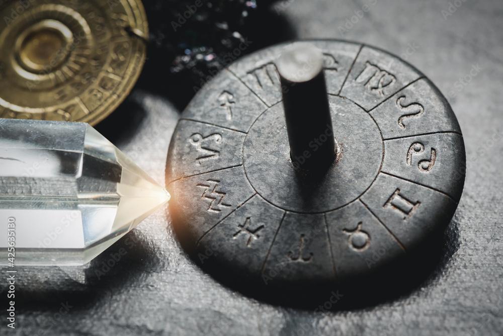 Fotografie, Obraz Horoscope zodiac wheel on the table close up. Aquarius sign.