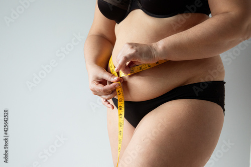 Fotografie, Tablou middle aged curvy woman body with belly diet concept