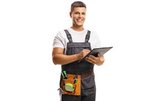 Smiling Young Repairman With A Tool Belt Writing On A Clipboard