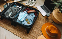 Packing Suitcase For Travel Vacation In New Normal