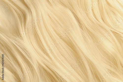 Fotografia close up texture of single piece elastic string tied wavy white blonde synthetic