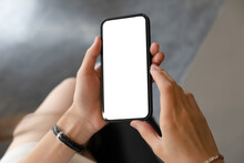 Close-up Of Woman's Hands Holding Blank Screen Smartphone.