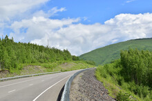 An Asphalt Road Among The Green Hills. A Bright Summer Day. Sikhote-Alin Mountains.