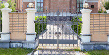 Wrought Iron Gates For A Temple Or Church. Image Of A Beautiful Decorative Cast Iron Wrought Fence And Gates With Artistic Forging And Stone Columns