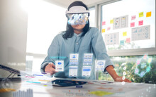 Asian Woman Using Augmented Reality (ar) Glasses Simulation Ux Ui Design For Working On Table At Office.virtual Reality Development Process Concept