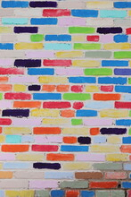 A Fragment Of A Textured Creatively Decorated Brick Wall With Bricks Of Different Colors