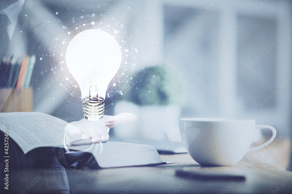 Fototapeta Double exposure of bulb drawing and desktop with coffee and items on table background. Concept of ideas.