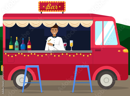 Obraz Truck with bartender making alcohol drink for young people. Men buying cocktails from outdoor bar - fototapety do salonu