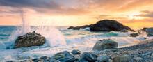 Sea Waves Break On Big Stone With Beautiful White Splashes, Sunrise. Panorama