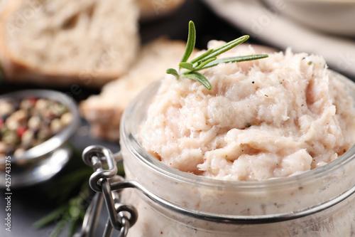 Fotografie, Obraz Delicious lard spread with rosemary in jar, closeup