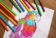 Child's Colored Drawing With Felt Tip Pens On Wooden Table, Flat Lay