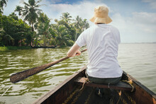 Tourist Man Floating On Alleppey Backwaters And Enjoying Beautiful View