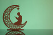 canvas print picture Eid Mubarak concepts with crescent moon in silhouette with man praying.