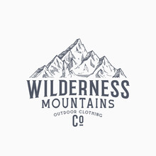 Wilderness Mountains Outdoor Clothing Vintage Vector Sign, Label Or Logo Template. Hand Drawn Mountain Peak Sketch With Retro Typography. Premium Branding Emblem. Isolated