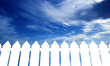 White Fence And Sky